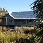 The outside of the restaurant, nestled in the marsh.