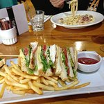 The toasted club sandwich and pasta carbonara.