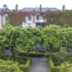 Bantry house with parterre garden and wisteria in the middle