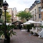 Garden patio at Les Jardins du Marais Hotel
