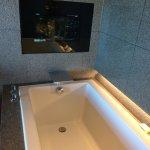 A TV by the bath tub!