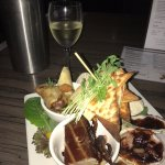 Smoked tuna & octopus, oysters, prawns, duck rolls, bread & dips