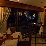 Dinning in the restaurant with city lights through the windows