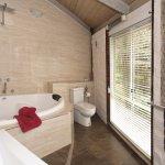Sunshine Red Mudbrick Cottage Huge Spa bath with overhead rainshower