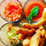 fried pizza with mixed sauce: guacamole, sambel mentah, fresh tomato