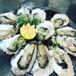 Carlingford Rock Oysters  served raw with mignonette dressing & lemon