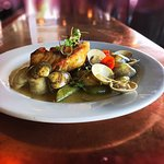 Halibut and Little Neck Clams served in Lemon Saffron Velute