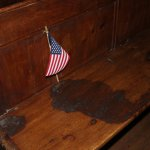 Bench inside the church that still retains its bloodstains