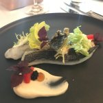 Sea bream fish with wasabi cream, caviar from haring and gel of soya