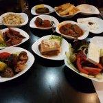 Mains L-R: chicken&pork souvlaki, loukanika, dolmades, keftedes, stifado, moussaka