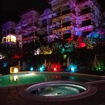 night photo of pool area of Shana hotel