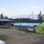 Hot/cold pool and diving area with loungers and locker rooms