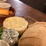 Baked Camembert with roasted garlic, and haloumi chips