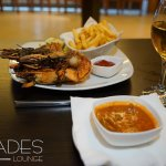 OUr special grilled prawn with chips and tomatoe sauce.