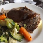 Medium Prime rib with mashed potatoes. gravy and vegetables