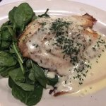 Stuffed Tilapia (stuffed and baked with a crab cake), lemon buerre sauce, spinach