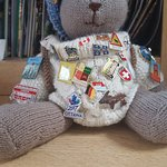 Rambler Ted with his badges from all over the world.