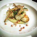 Fresh scallops on a curried parsnip puree topped with parsnip crisps, watercress & pomegranate s