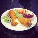 Home-made Brie wedges; coated in thick breadcrumb, fried until golden. (Specials)