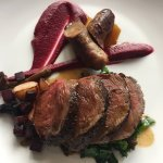Venison haunch, smoked venison & belly pork sausage, rosemary beetroot purée, gin & juniper jus