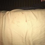 unknown stains on bed