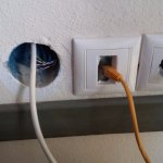 Plug sockets showing bare wires