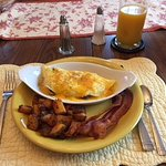 Omelet, Home Fries, Bacon, Juice