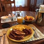 French Toast, Scrambled Eggs, Linguica, Fruit, Juice