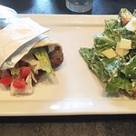 Greek Gyro (sliced beef and lamb) with lettuce, tomatoes, tzatziki sauce, and fries