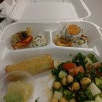 Fresh Sushi, vegetable roll and kale, garbanzo, cucumber and tomato salad, very delicious.