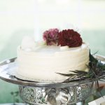 Flourless chocolate cake with praline filling and vanilla buttercream frosting