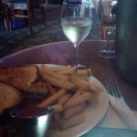 Sandwich & fries and bottle of wine