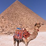 one of the locals posing for a shot in front of the pyramids.