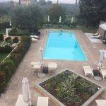 garden below, pool, city in the background