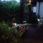 Downstairs decking area at dusk with solar lights