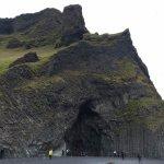 Black sand beach mountain/caves.