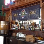 The bar in Schilo's including the root beer keg and the banner honoring 100 years of operation h