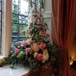 The rooms and hallways were filled with beautiful fresh bouquets of flowers.