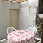 Outdoor table with linen tablecloth.