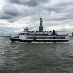 Ferry with Statue of Liberty in background. Ferry is located across the street from the Ritz