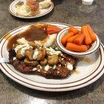 black n bleu steak with potatoes and carrots