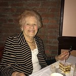 Here is my Mom at her birthday dinner having her special dessert-tiramisu with a candle on top!