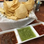 Complimentary chips and 3 salsas (spicy, medium, mild)