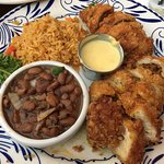 Stuffed Chicken Medallions (stuffed with chorizo, poblano peppers, cheese, fried) w/beans and ri
