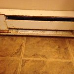 Litter, gross sliding door track, outdated stove, rusted heater