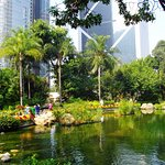 The park is flanked by tall buildings