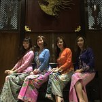 Beautiful Phoenix behind ladies in sarong kebaya