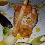 Pan seared red tuna steak with mango, exotic sauce.