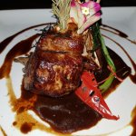 Rack of lamb with rosemary, strong lamb gravy served with creamy risotto