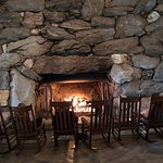 Large natural stone fireplace in the main lobby